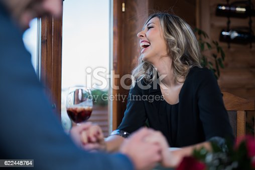Young couple laughing and holding hands