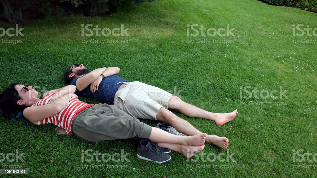 They pinion on grass at park