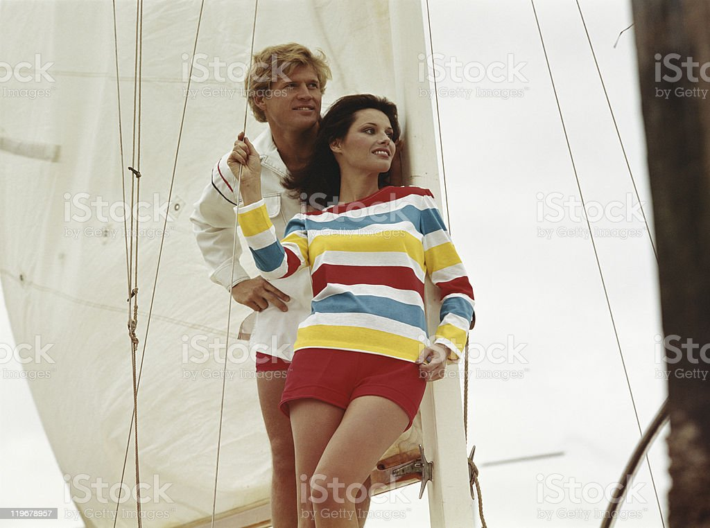 Young couple leaning against sail stock photo