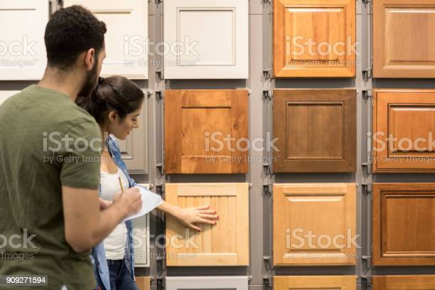 Young couple look at cabinet samples in home improvement store picture id909271594?b=1&k=6&m=909271594&s=612x612&h=g398iw3mvnrzc98s 173s1tq u ab uqot8zyz5kxlu=