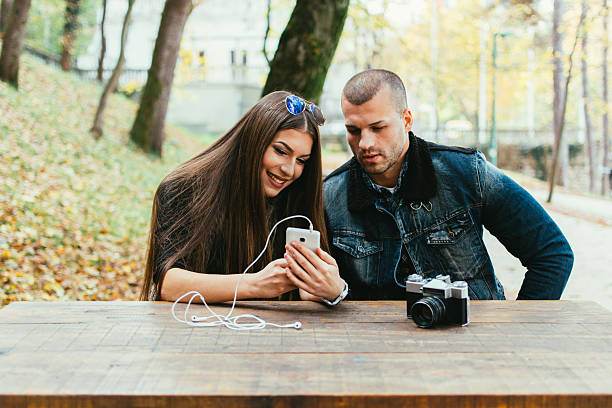 Young couple look at phone stock photo