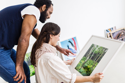 Young Couple Looking at Artwork in Gallery