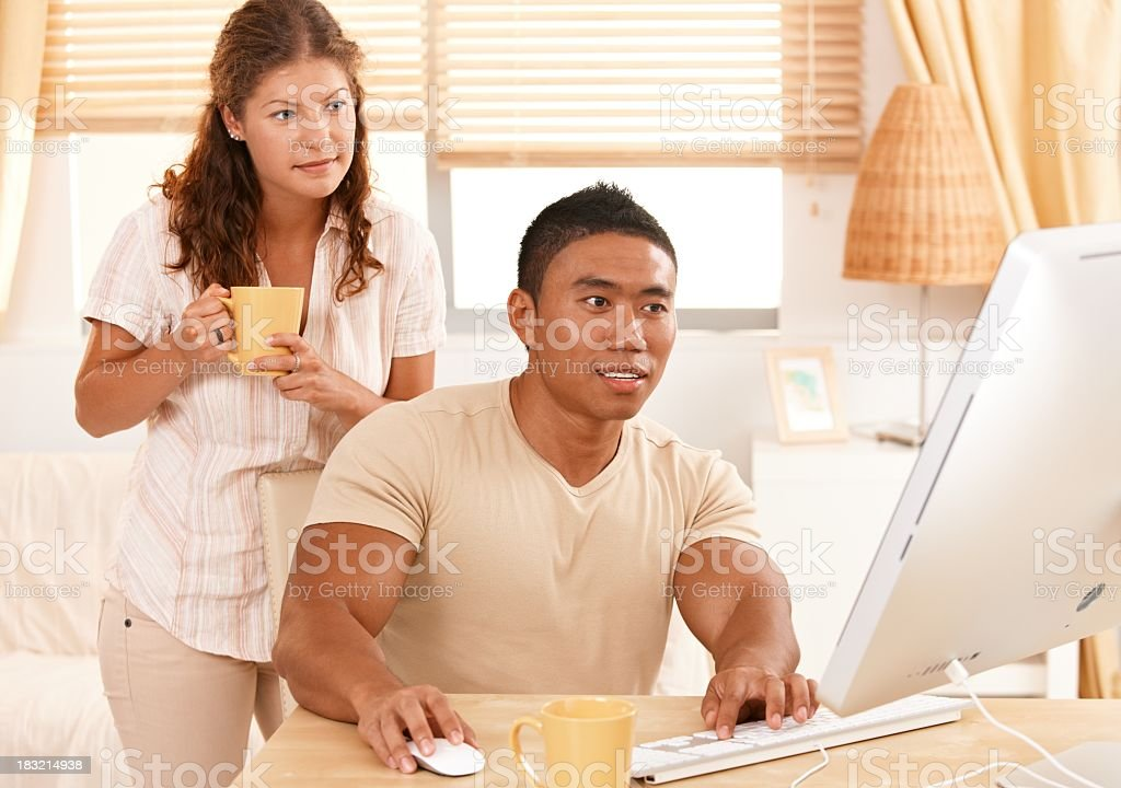 Young couple looking at computer monitor royalty-free stock photo