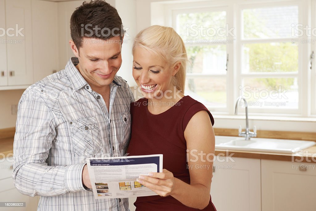 Young Couple Looking At Details For New Home stock photo