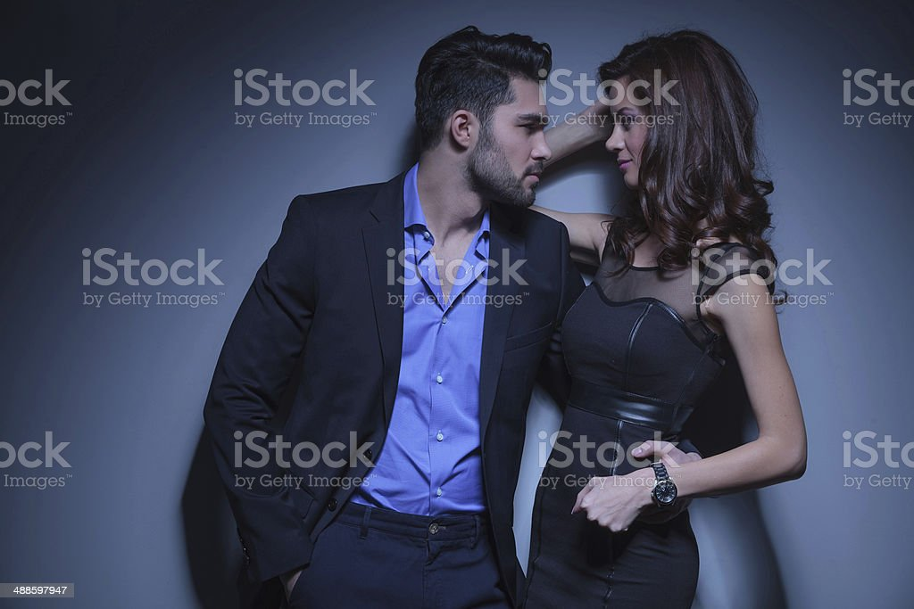 young couple looking at each other stock photo
