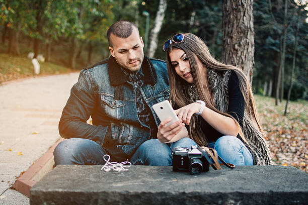 Young couple looking at phone stock photo