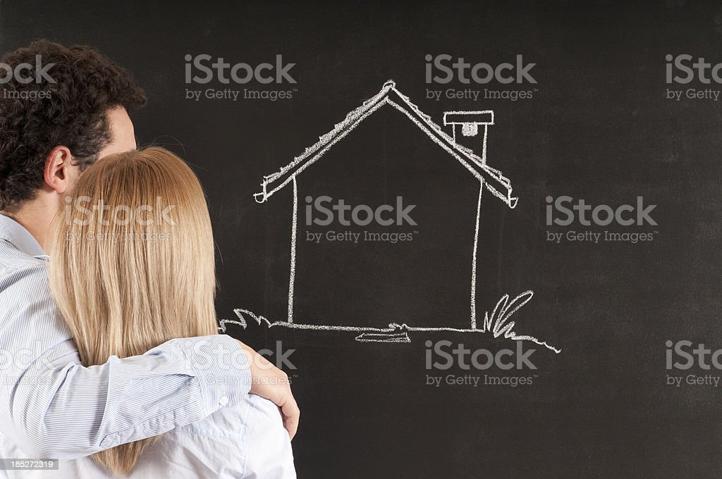 Young Couple Looking at Sketched Home royalty-free stock photo