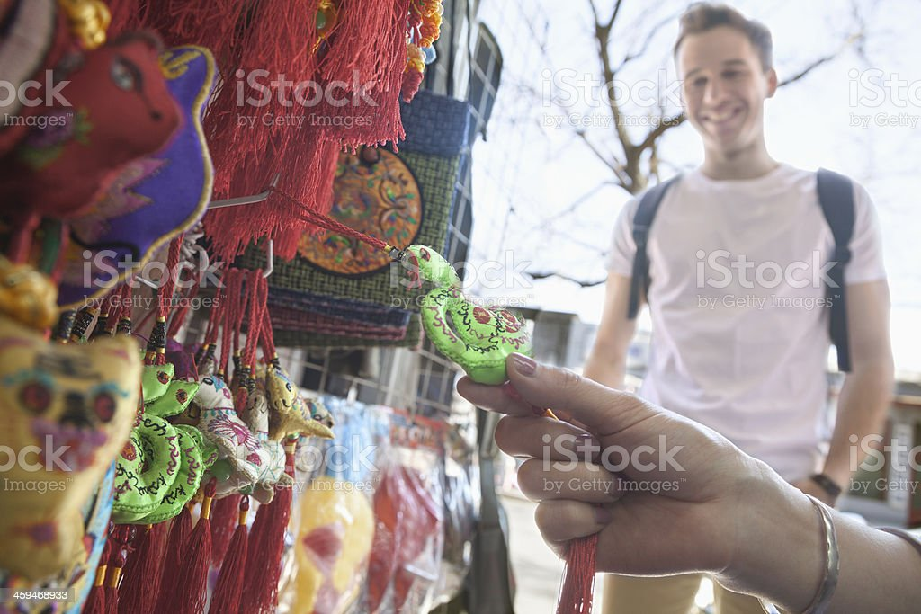Young couple looking at souvenirs. stock photo