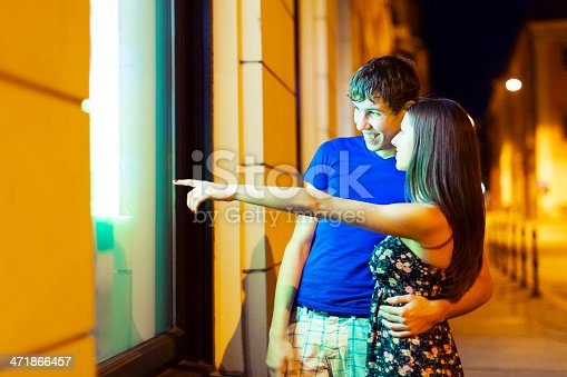 Young couple looking at store display and planning their future.