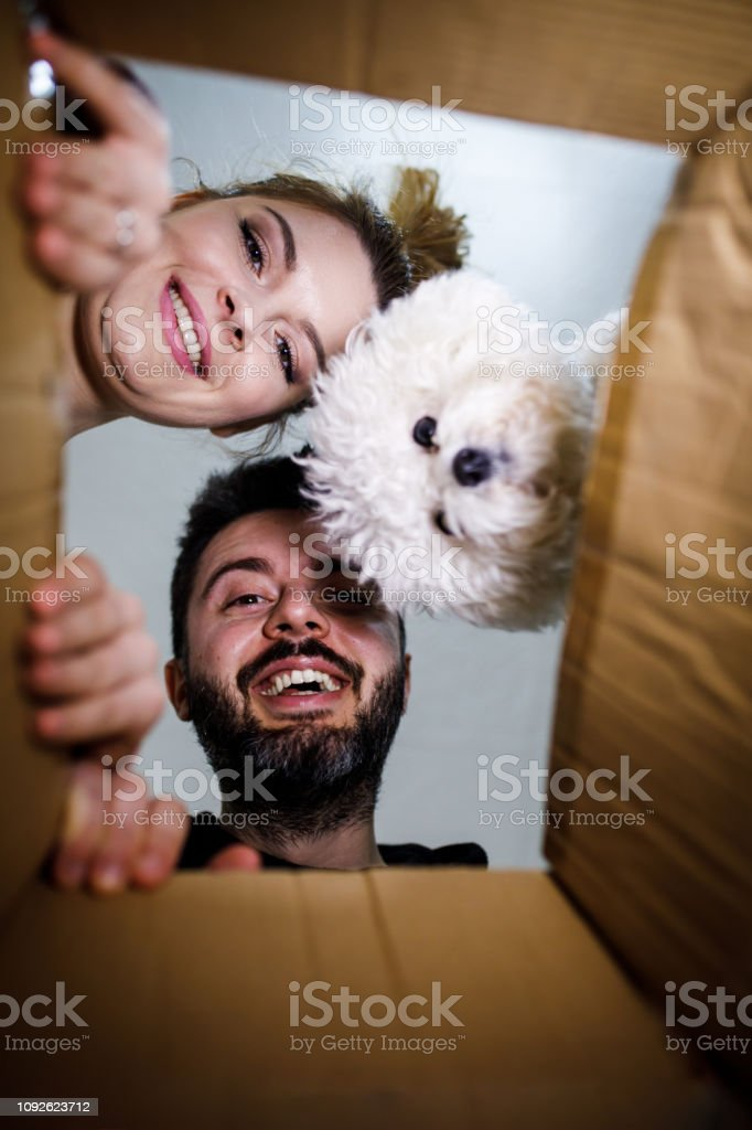 Young couple looking into the box stock photo
