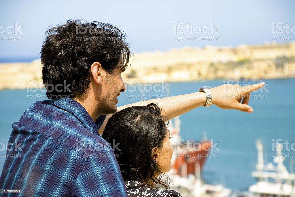 Young couple looking into the distance royalty-free stock photo