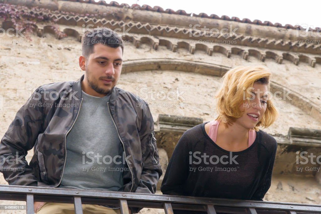 Young couple looking out of the terrace. Human relationships.