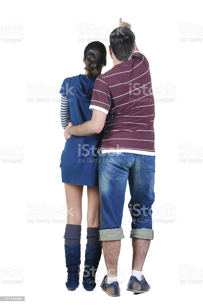 Young couple looks where that. Rear view. royalty-free stock photo