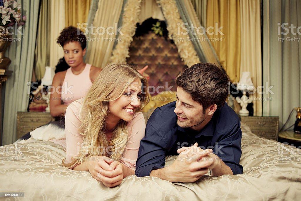 Young Couple, Luxurious Bedroom, Jealousy stock photo