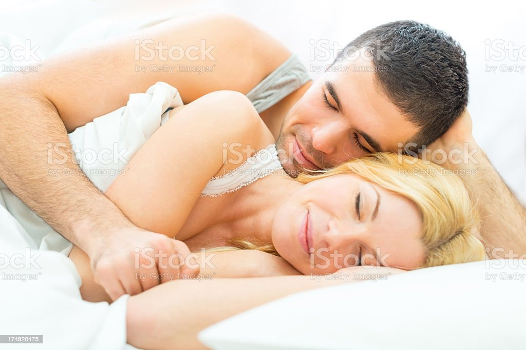 Young couple lying in bed royalty-free stock photo