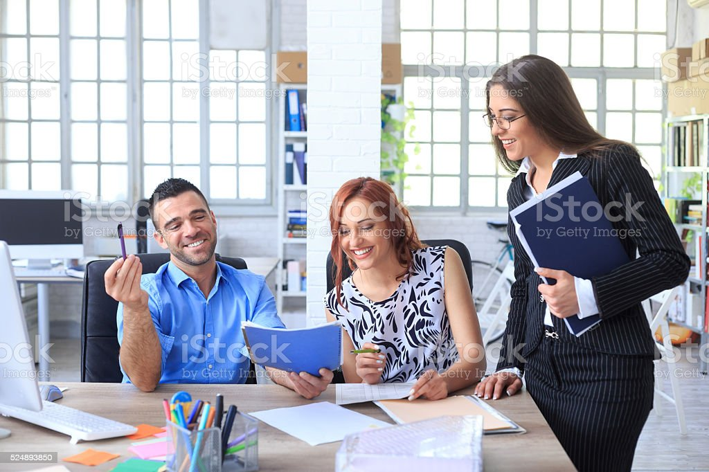 Young couple making a deal for sale stock photo