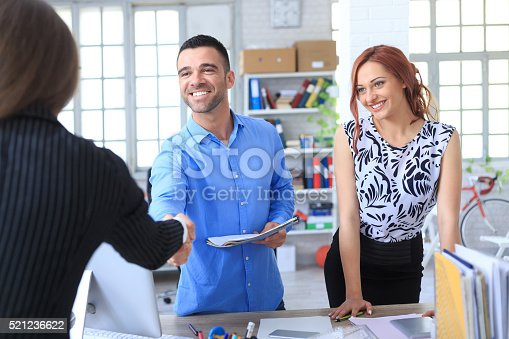 istock Young couple making a deal 521236622