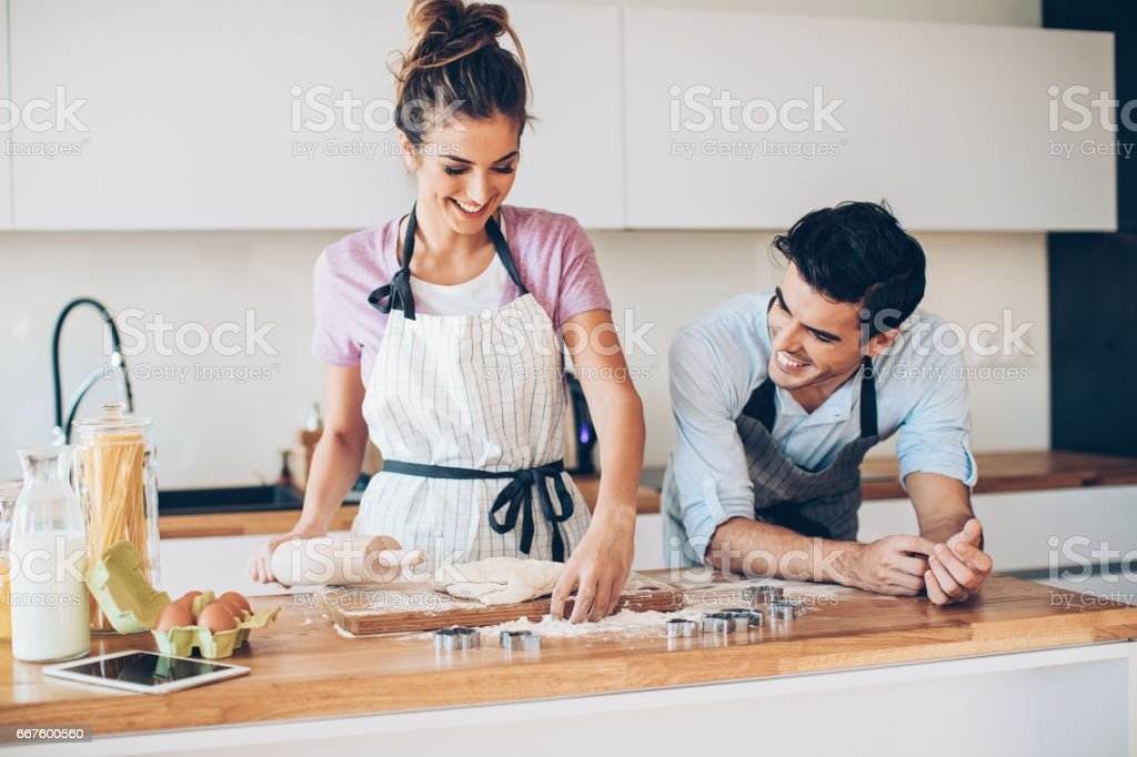 Young couple making cookies stock photo