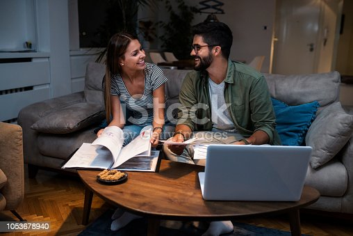 istock Young couple making joint future plans 1053678940