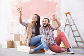 Young couple making plans for home improvement