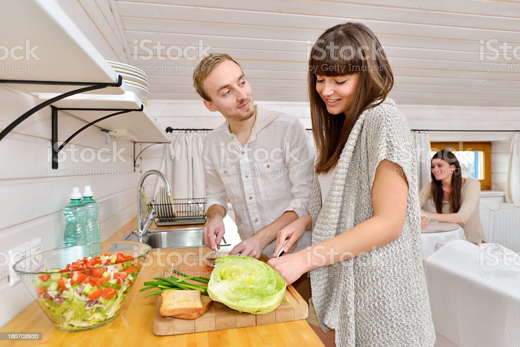 Young couple making salad in the kitchen royalty-free stock photo