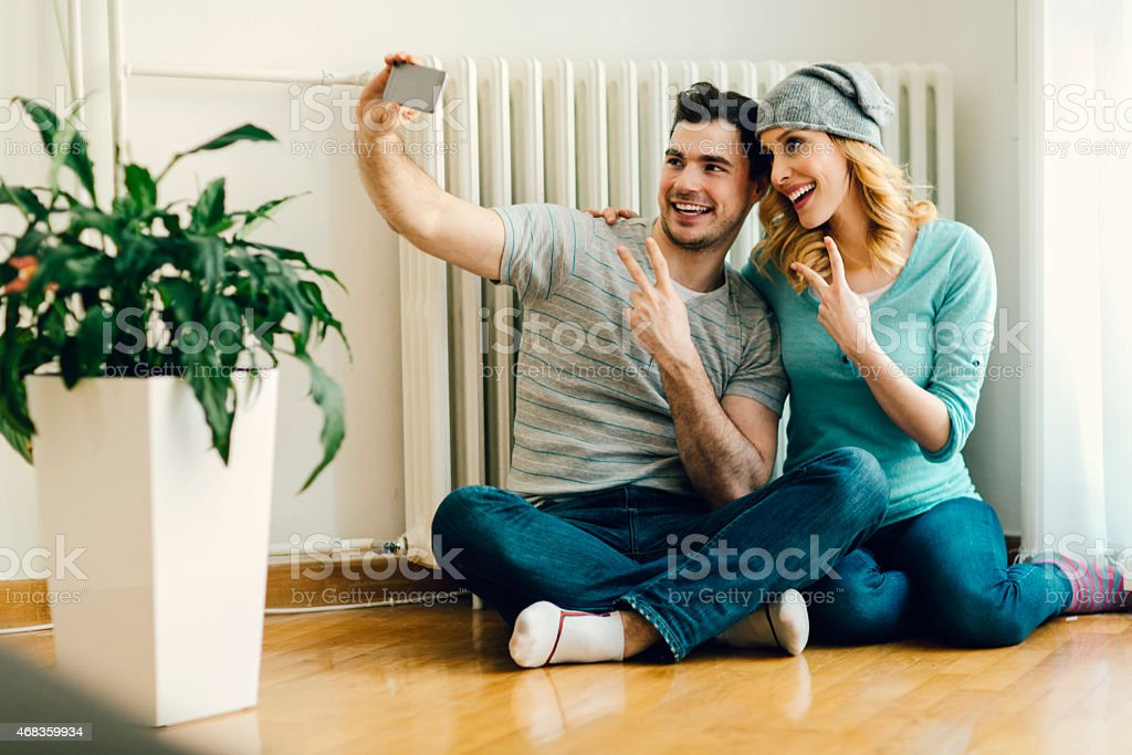 Young Couple Making Selfies At Home. royalty-free stock photo