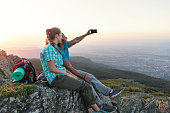 Young couple making selfies high up in the mountains