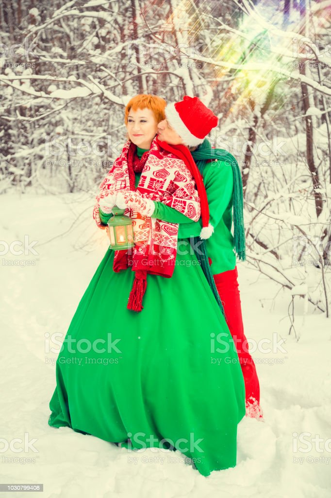 Young Couple Man And Woman Husband And Wife Are Walking In Costumes