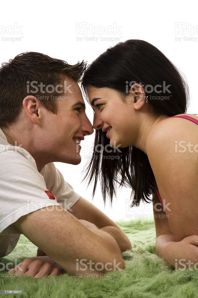 young couple man woman love facing eachother isolated carpet hispanic royalty-free stock photo
