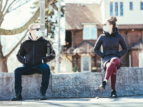 istock COVID-19, Young couple meeting outside 1214307609