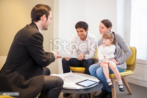 istock Young Couple meeting real-estate agent to buy property 482635293