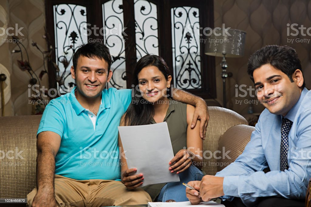 Young Couple Meeting Realestate Agent To Buy Property