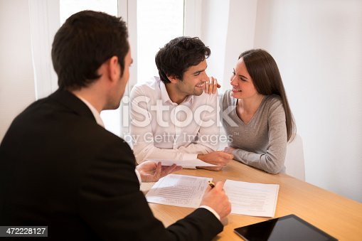 466848706 istock photo Young Couple meeting real-estate agent to buy property, presentation tablet 472228127