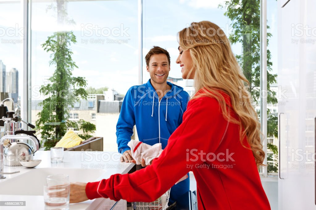 Young couple morning Happy young couple cleaning kitchen after the breakfast in the morning.  20-24 Years Stock Photo