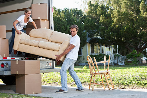 young couple moving house - carrying stock pictures, royalty-free photos & images
