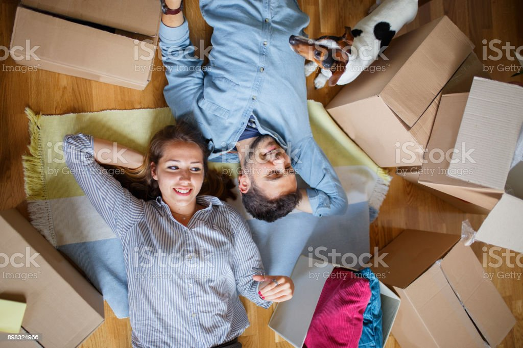 Young couple moving in into new apartment stock photo