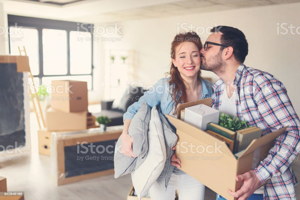 Young couple moving in new home stock photo