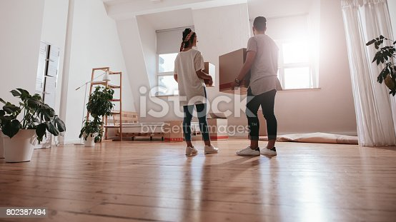istock Young couple moving in new house 802387494