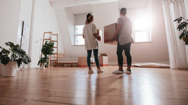 Young couple moving in new house stock photo