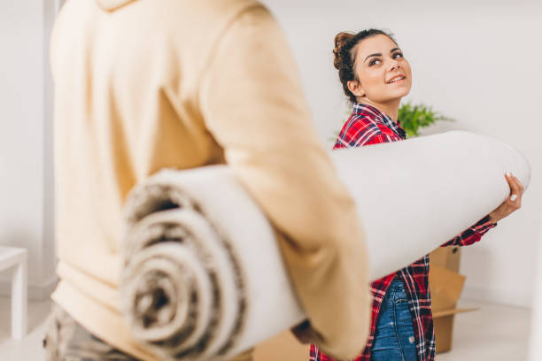 Young couple moving in to new house stock photo