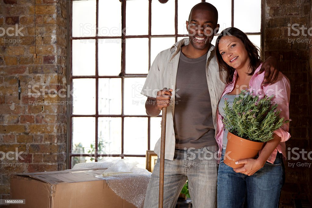 Young Couple Moving Into a New Apartment royalty-free stock photo