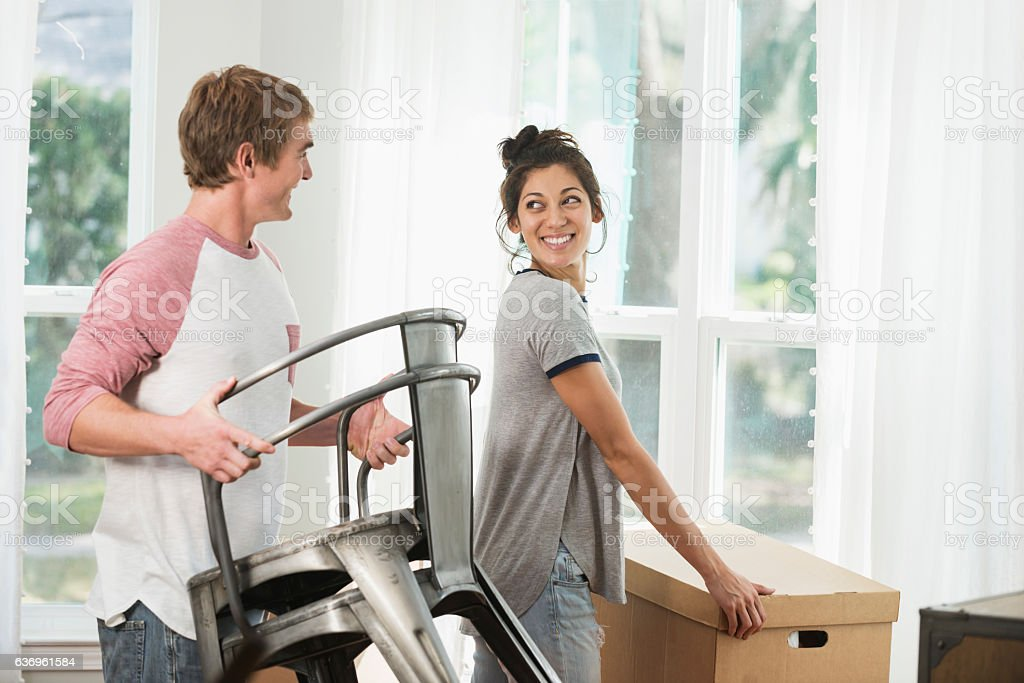 Young couple moving into new home or apartment stock photo