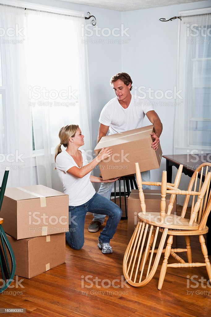 Young couple moving into new home royalty-free stock photo