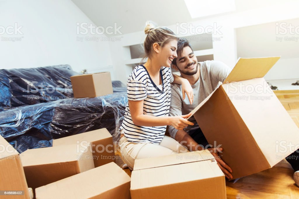 Young couple moving into their new home stock photo