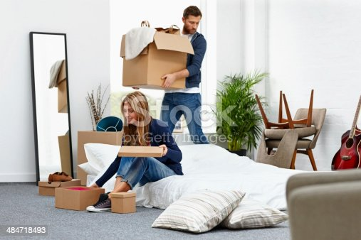 istock Young couple moving into their new house 484718493