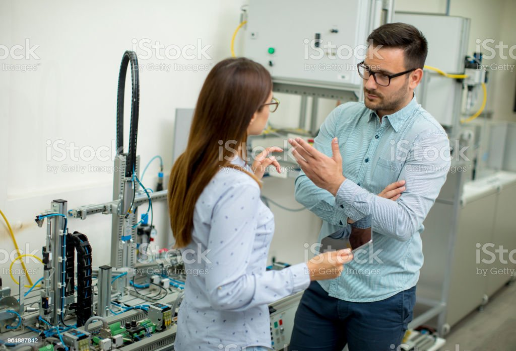 Young couple of students at robotics lab royalty-free stock photo