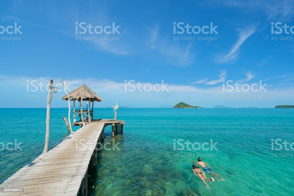 Young couple of tourists snorkel in crystal turquoise water near tropical resort in Phuket, Thailand. Summer, Vacation, Travel and Holiday concept. stock photo