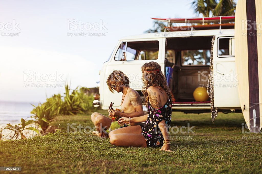 young couple on a beach stock photo