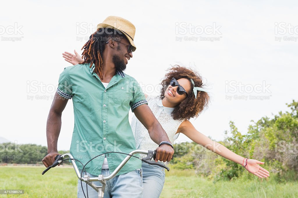 Young couple on a bike ride stock photo