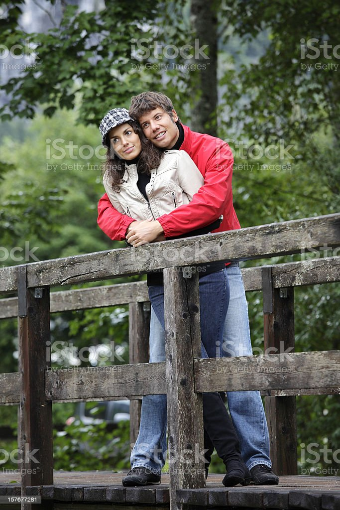 Young couple on a bridge royalty-free stock photo